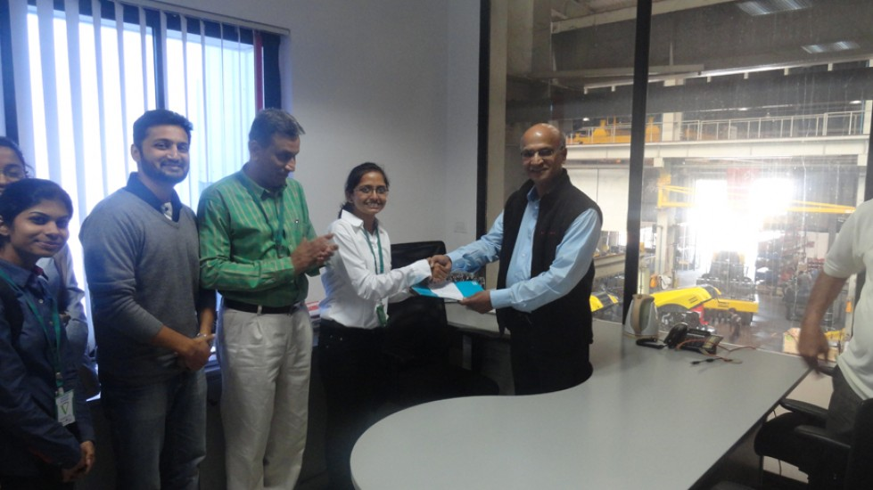 Felcitation of Ms.Madhri Patil- Lady Topper- Third Year Mechanical Eng-at-hands of Mr.Pandit GM-Atlas Copco