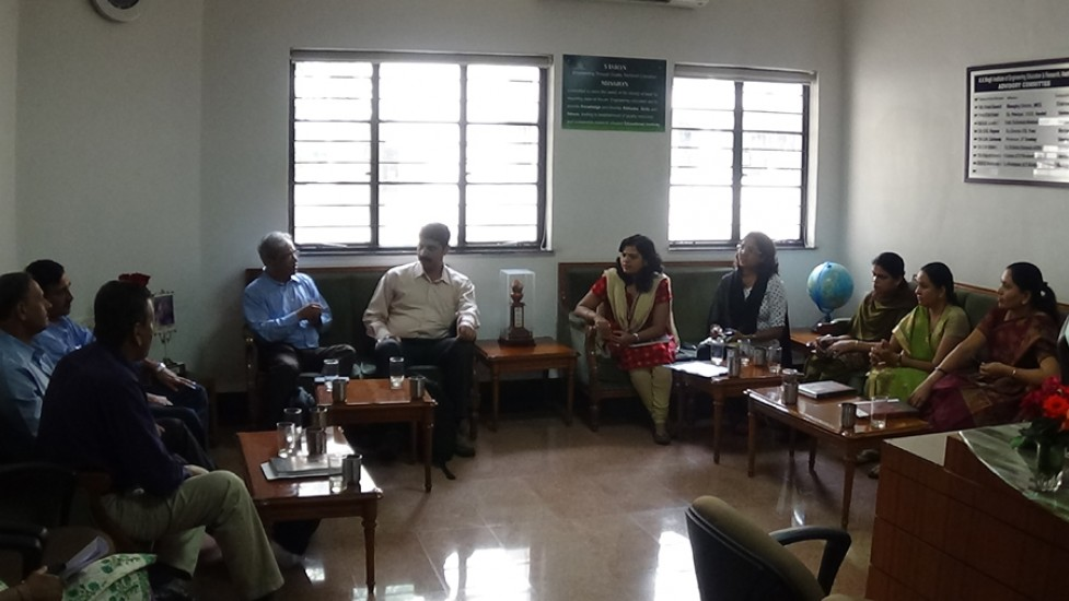 Persistant HR Head intercating with Principal, HODs and Staff in Principal Office