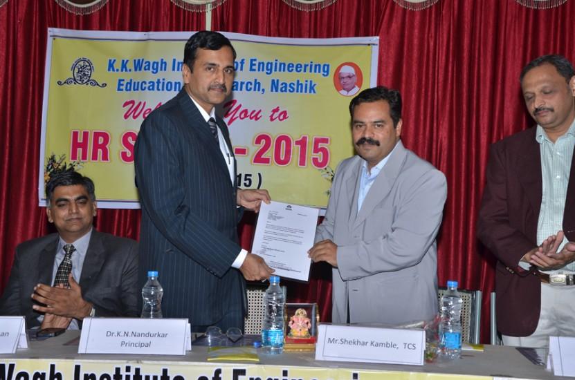 TCS HR Head handing over TCS Acreditation Letter to Principal Dr K N Nandurkar